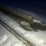 En delvis nedsnødd benk på Storberget