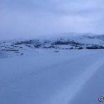 Storberget kan så vidt skimtes i snøen